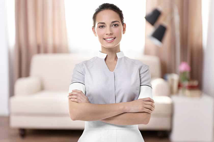 image of housekeeping lady smiling with arms crossed